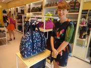 Kate Spade Saturday Creative Director Theresa Canning Zast poses with a weekender bag.