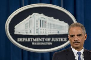 Eric Holder, U.S. attorney general, listens to a question during a news conference.