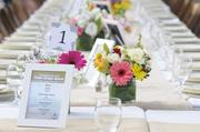 A table is set in preparation for the Farm-to-Fork Tower Bridge dinner.