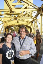 Lisa Schulz and Jim Mills of Produce Express pose on the Tower Bridge, ahead of the Farm-to-Fork dinner.