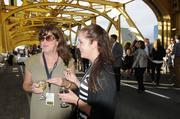 Terry Gilbert and Emily Murphey stand on the Tower Bridge before the Farm-to-Fork dinner begins.