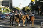 Mounted police from the city of Sacramento keep an eye on traffic. The Tower Bridge was blocked between 1 and 10 p.m. You can see the Capitol in the distance.