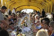 It's time to eat at the Farm-to-Fork dinner on the Tower Bridge.
