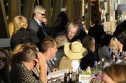 Guests at the Farm-to-Fork dinner on the Tower Bridge are seated.