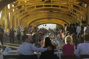 Dinner guests enjoy their dinner in the golden afternoon and evening on the iconic Tower Bridge.