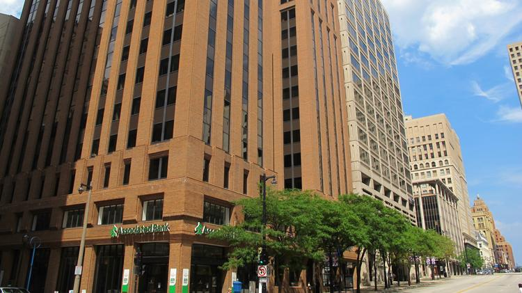 The reddish First Financial Centre building and its neighbor, the 250 Plaza at right, are being sold.