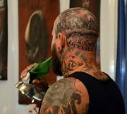 A tattoo on the head of Chad Best is shown during the Jacksonville Tattoo Convention.