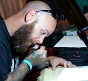 Jason Holley draws a tattoo during the Jacksonville Tattoo Convention.