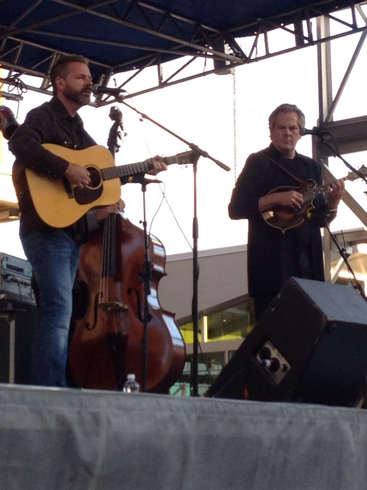 Veteran bluegrass musicians Jon Randall (right, on guitar) and John Jorgenson (left, on mandolin) with the John Jorgenson Bluegrass Band take the City Plaza stage.