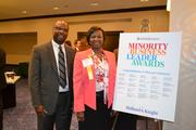 From e-Management, Bambo Bamgbose, left, president and chief financial officer, with honoree Ola Sage at the 2013 Minority Business Leader Awards.