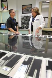 Shawn Kitchell, senior vice president of operations and Dr. Timothy Herod, research and development manager, conduct performance tests for accelerated aging of window film.