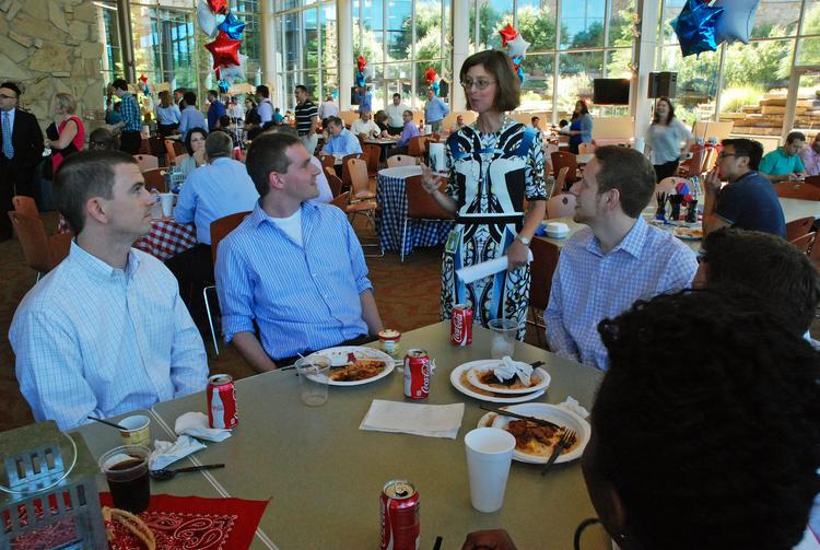 Nick Meyer, Daniel Eckl, Chase Southern, Ryan Longobardo and Ashley Scott talk with Fidelity Financial Services President Abby Johnson, center, after she addressed employees.