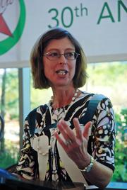 Abby Johnson, president of Fidelity Financial Services, addresses employees about the company's 30 years of business in Texas.