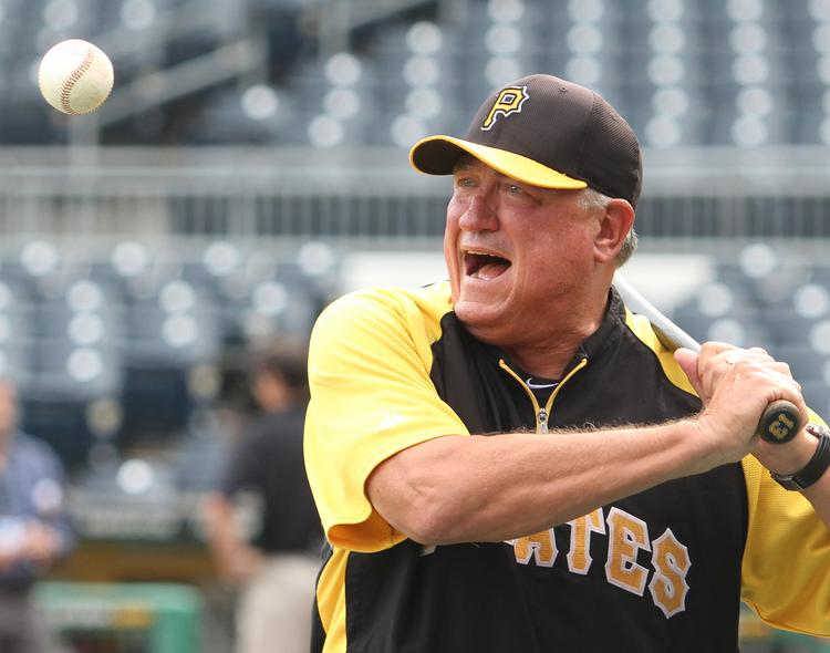 Pittsburgh Pirates manager Clint Hurdle hits grounders during batting practice at PNC Park August 28, 2013.  JOE WOJCIK PHOTO
