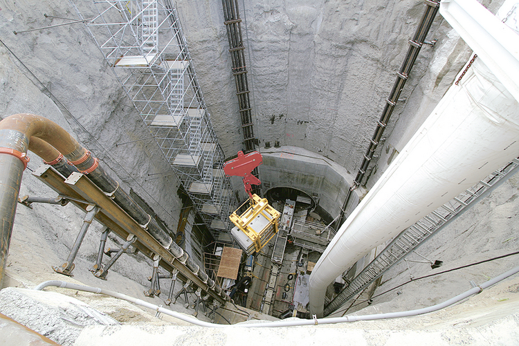 Work proceeds on Portland's $1.4 billion Big Pipe stormwater system prior to its 2011 completion. This shaft, near the Portland Opera building in Southeast Portland, provided access to the lateral tunnel below. When construction wrapped up, the shaft was filled and a parking lot was constructed at the surface.