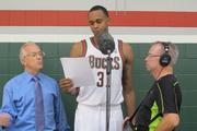 John Henson practiced his lines while preparing to record a message. Bucks executive vice president John Steinmiller is at left.