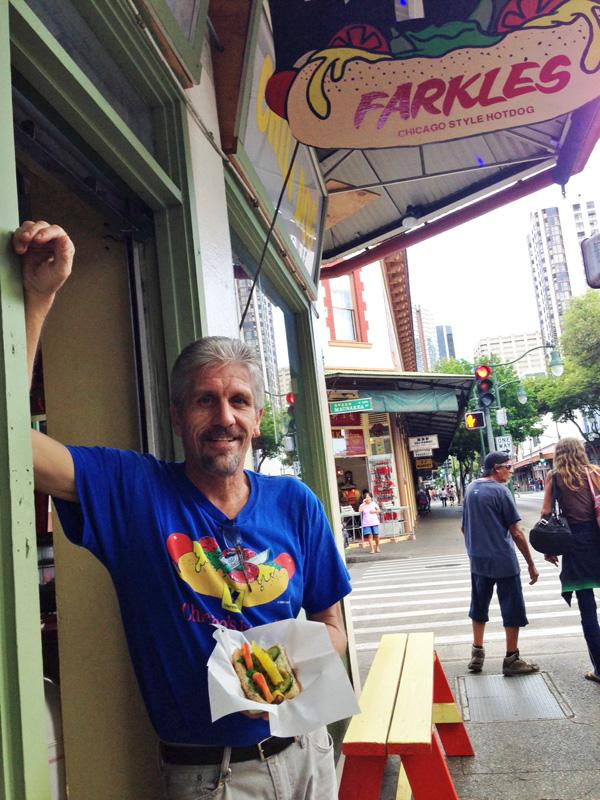 Marc Jensen shows off a Chicago-style hot dog at his new restaurant, Farkles, in Honolulu's Chinatown neighborhood.
