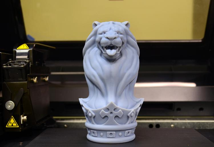 A sculpture, made in the 3-D printer, sits on the printer bed.