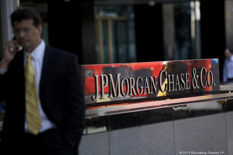 A man on a mobile phone walks by the offices of JPMorgan Chase in New York.