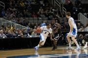 St. Louis' Kwamain Mitchell moves the ball inside.
