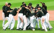 Pittsburgh Pirates catcher Russell Martin (55) is swarmed by teammates after Martin got a walk-off, 10th inning RBI to give the Pirates a 5-4 win over the Miami Marlins Aug. 8 at PNC Park. Martin came to the PIrates as a free agent in the off season and has been instrumental in the pennant chase.