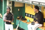 Pittsburgh Pirates outfielder Andrew McCutchen, left, and catcher Russell Martin talk in the dugout during batting practice Aug. 28.