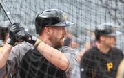 On his first day with the team, Pittsburgh Pirates catcher John Buck hits in the cage during batting practice at PNC Park Aug. 28.
