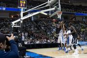 New Mexico No. 12 Devon Williams takes it up for a basket.