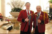Peabody Orlando Duckmaster Donald Tompkins (right) and his student and Peabody Memphis Duckmaster Anthony Petrina pose with the ducks and their duck canes.