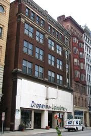 The Mill End Drapery Building, located at 26 W. Seventh St., is listed for $975,000 on the commercial real estate listing website LoopNet by Don Murphy with Cassidy Turley Commercial Real Estate Services.