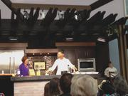 Disney host Pam Smith, left, and Chef Carla Hall from ABC's The Chew kept the audience engaged during a Chef's Showcase presentation at the Epcot International Food & Wine Festival.