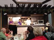 Chef Carla Hall from The Chew brought one of her signature recipes to the Epcot International Food & Wine Festival Chef Showcase demonstration.