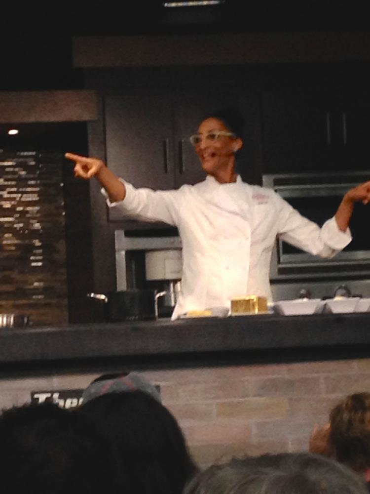 "Chef Carla Hall of ABC's The Chew and former Top Chef finalist, brought her big, fun personality and signature call-and-reply ""Hootie hoo!"" cry to the Epcot International Food & Wine Festival's chef demonstration."