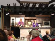 Margaret Curry of Murphy-Goode Winery, left, and Disney host Pam Smith warm up the crowd in preparation for celebrity Chef Carla Hall during a culinary presentation at the Epcot International Food & Wine Festival.