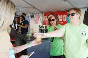 Representatives from Triple C Brewing Co., one of Charlotte's newest breweries, pour samples for festival-goers at Charlotte Oktoberfest.