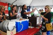 Bridsong Brewing Co. hands out samples of its beer at Charlotte Oktoberfest.