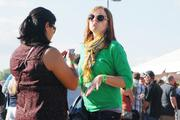 Festival-goers dance to music from live entertainers.