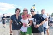 Oktoberfest attendees pause for a photo op.