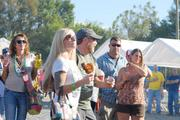 Oktoberfest attendees dance as Southern Culture on the Skids performs.