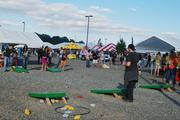 Festival-goers played cornhole and other games.