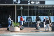 Tourists pass the Newseum on Segways. The museum will remain open daily throughout the shutdown, from 9 a.m. to 5 p.m.