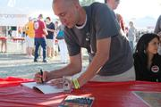 Author Daniel Hartis signs copies of his book, Charlotte Beer.