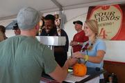 Oktoberfest attendees sample seasonal brews from Four Friends Brewing of Charlotte.