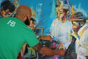 Local artist John Hairston Jr. of All City Studios works on a painting at the Heist Brewery tent.