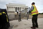 Members of the Park Service place barricades in front of the Lincoln Memorial.