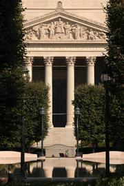 The fountains are turned off and the sculpture garden is closed at the National Archives building on the National Mall.