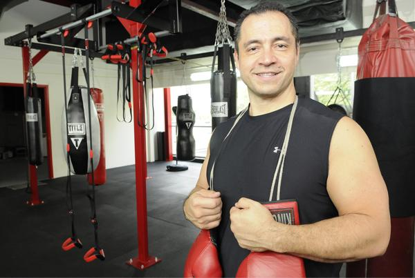 Snooky Fujikawa shows off his new fitness center and boxing studio on the second floor at 1646 Kapiolani Blvd. He says Punch by Mono E Mono is not a traditional boxing gym, but rather a venue for people who want to get in shape using a boxing platform. He says many of his customers are business executives.