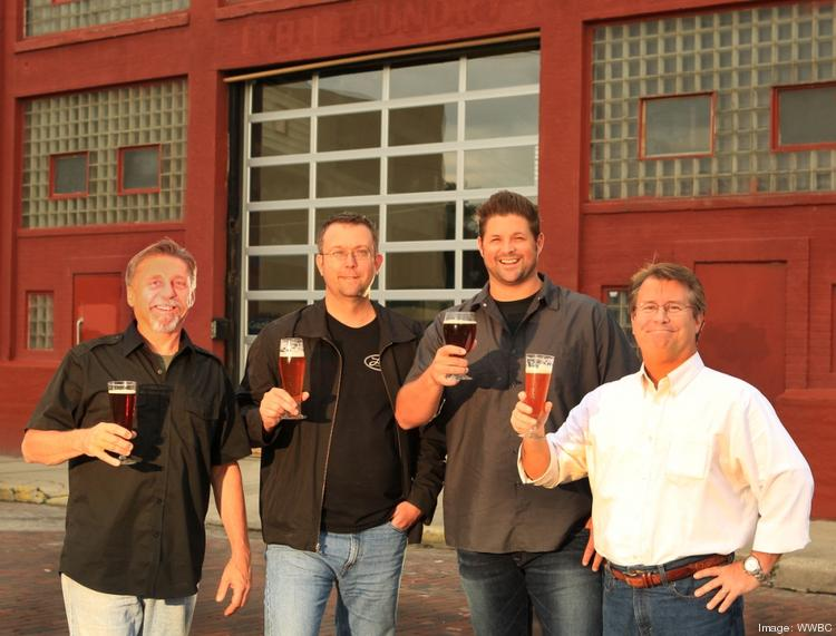 Warped Wing Brewing Partners in front of the brewery in downtown Dayton. (Left to right) Joe Waizmann, John Haggerty, Nick Bowman and Mike Stover.