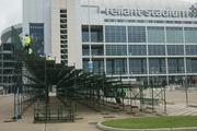 A grandstand with a clear view of Reliant Stadium