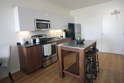 A view of the kitchen in a one-bedroom unit at The Emery, which opened over the weekend at Portland's South Waterfront.